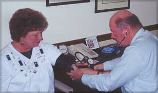 Dr. Wells treating a patient for Hypertension